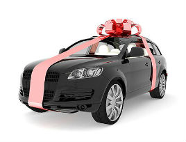 black car with pink bow gift ribbon