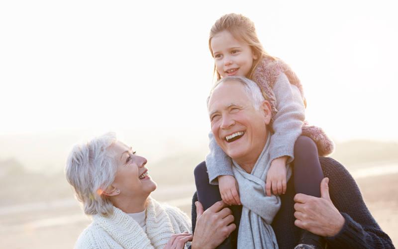 Grandparents and Granddaughter Walking